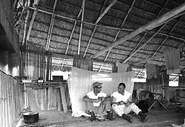 Ted Long and Chuck Clark in their hut in the Amazon Rainforest